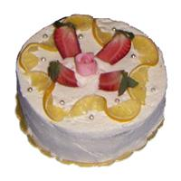 Tort z owocami i bitą śmietaną